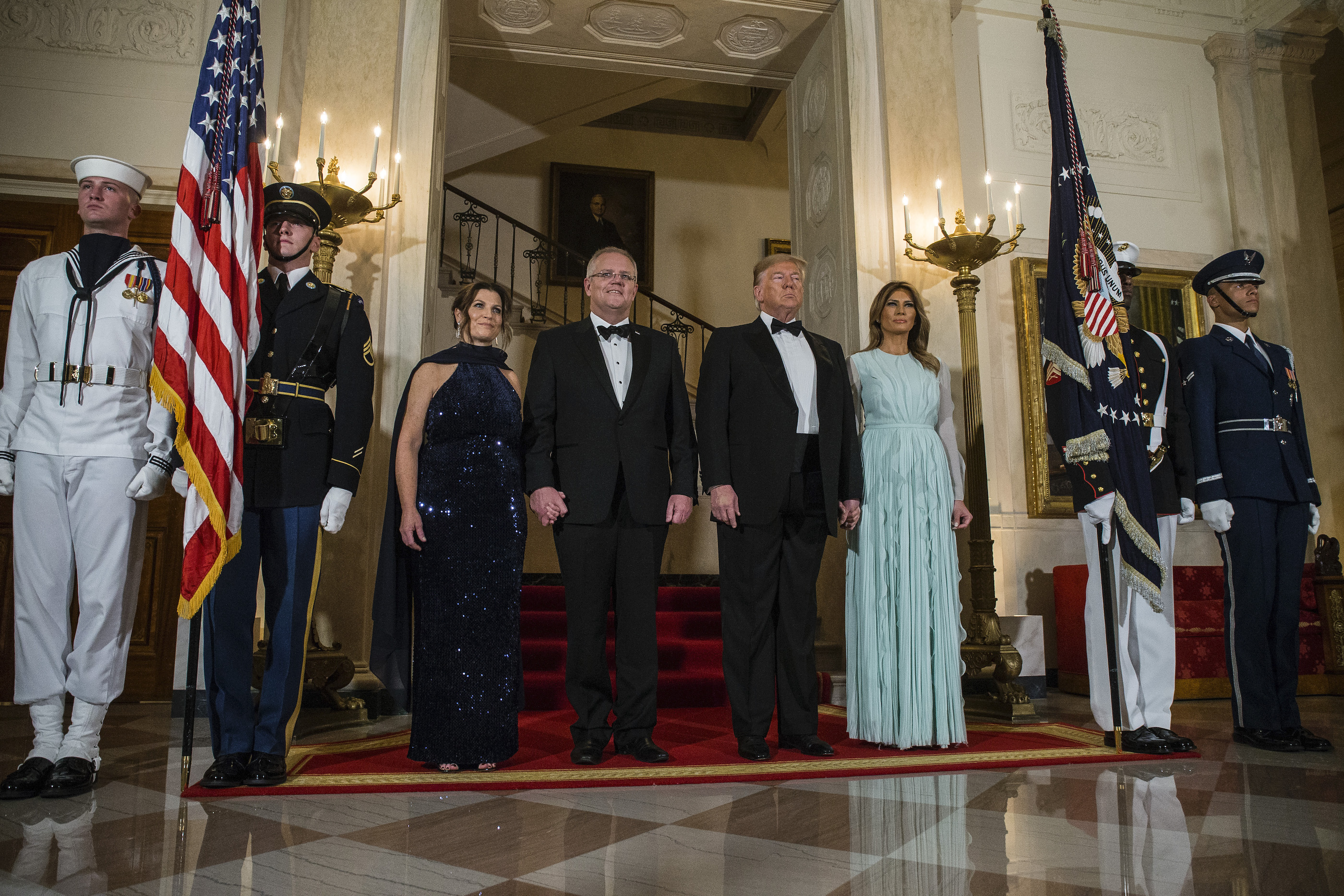 President Donald Trump and first lady Melania Trump, Australian Prime Minister Scott Morrison, and his wife, Jenny, in the White House Grand Foyer.