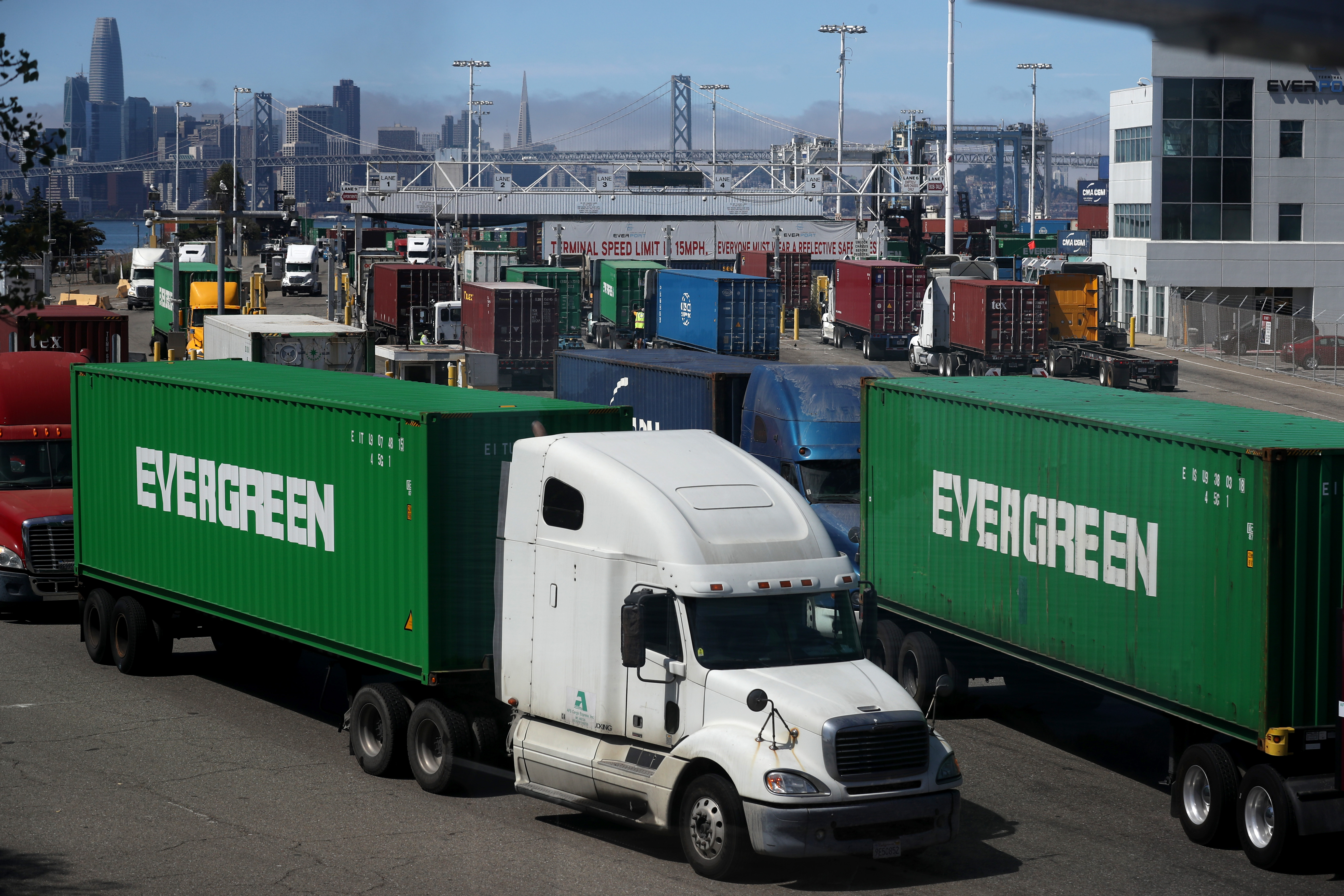 OAKLAND, CALIFORNIA - SEPTEMBER 03: Trucks move containers in and out of the Ben E. Nutter terminal at the Port of Oakland on September 03, 2019 in Oakland, California. The Dow Jones Industrial Average fell nearly 300 points on Tuesday as the United States imposed 15% tariffs on some Chinese goods this past Sunday and China also imposed new charges on products from the United States. (Photo by Justin Sullivan/Getty Images)
