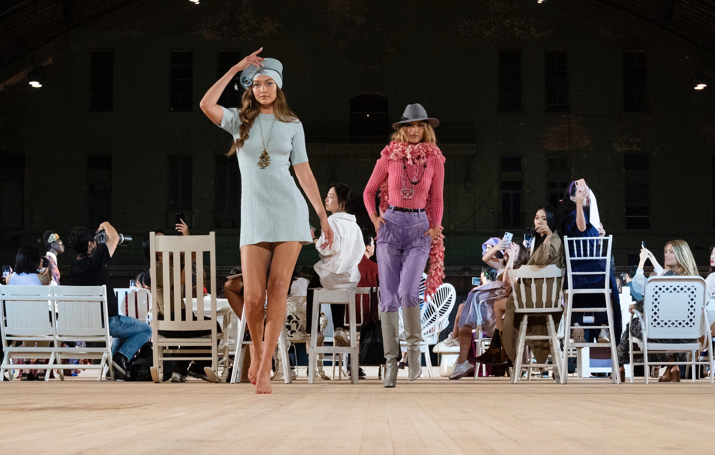 Modeling Marc Jacobs' ode to fashion through the years, Gigi Hadid, left, sports a mini dress and hat resembling a 1960s airline hostess uniform, as her sister Bella Hadid wears a nouveau cowboy design.