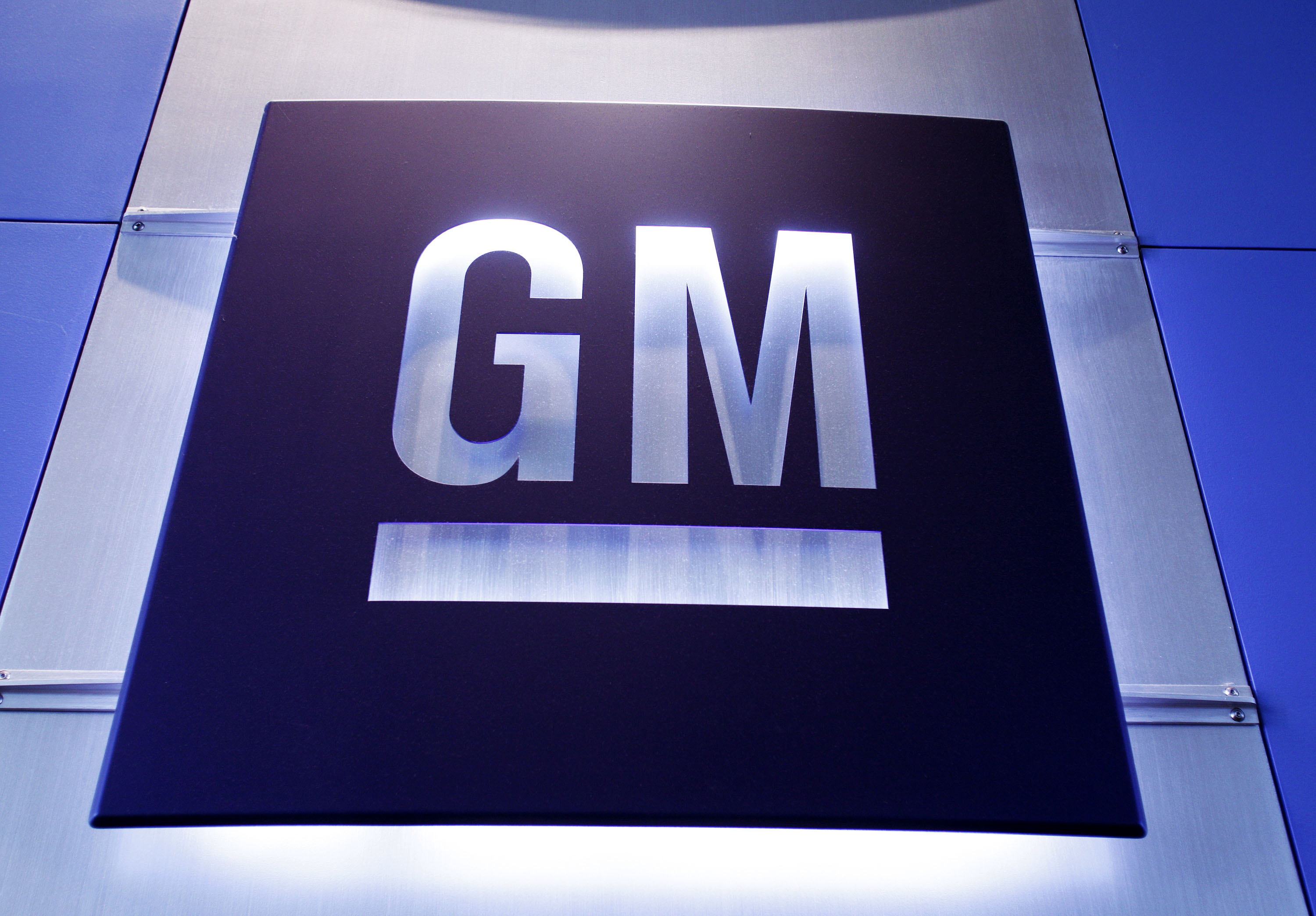 A General Motors logo is shown at the General Motors Technical Center.