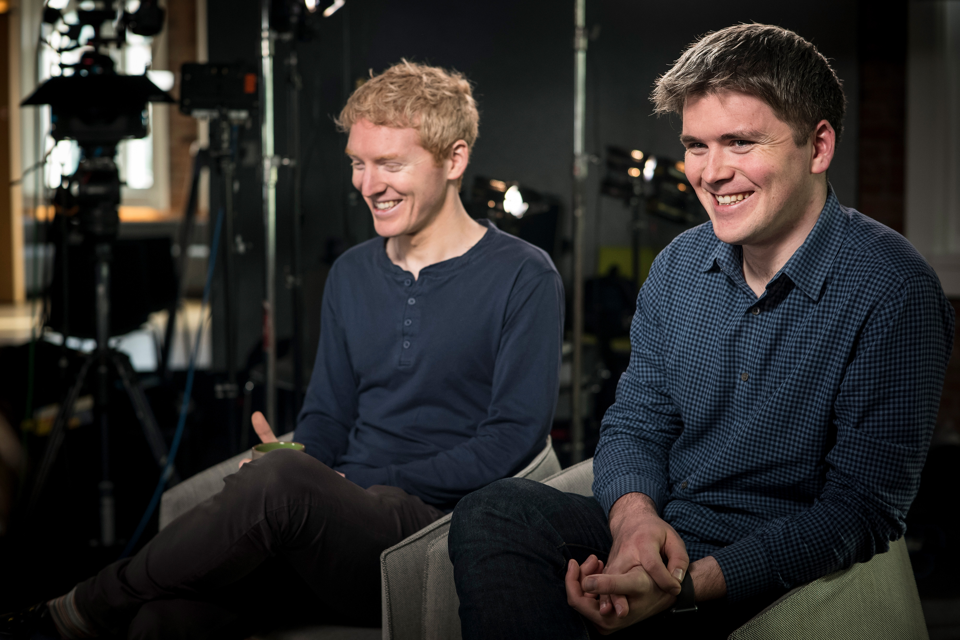 John and Patrick Collison sit next to each other.