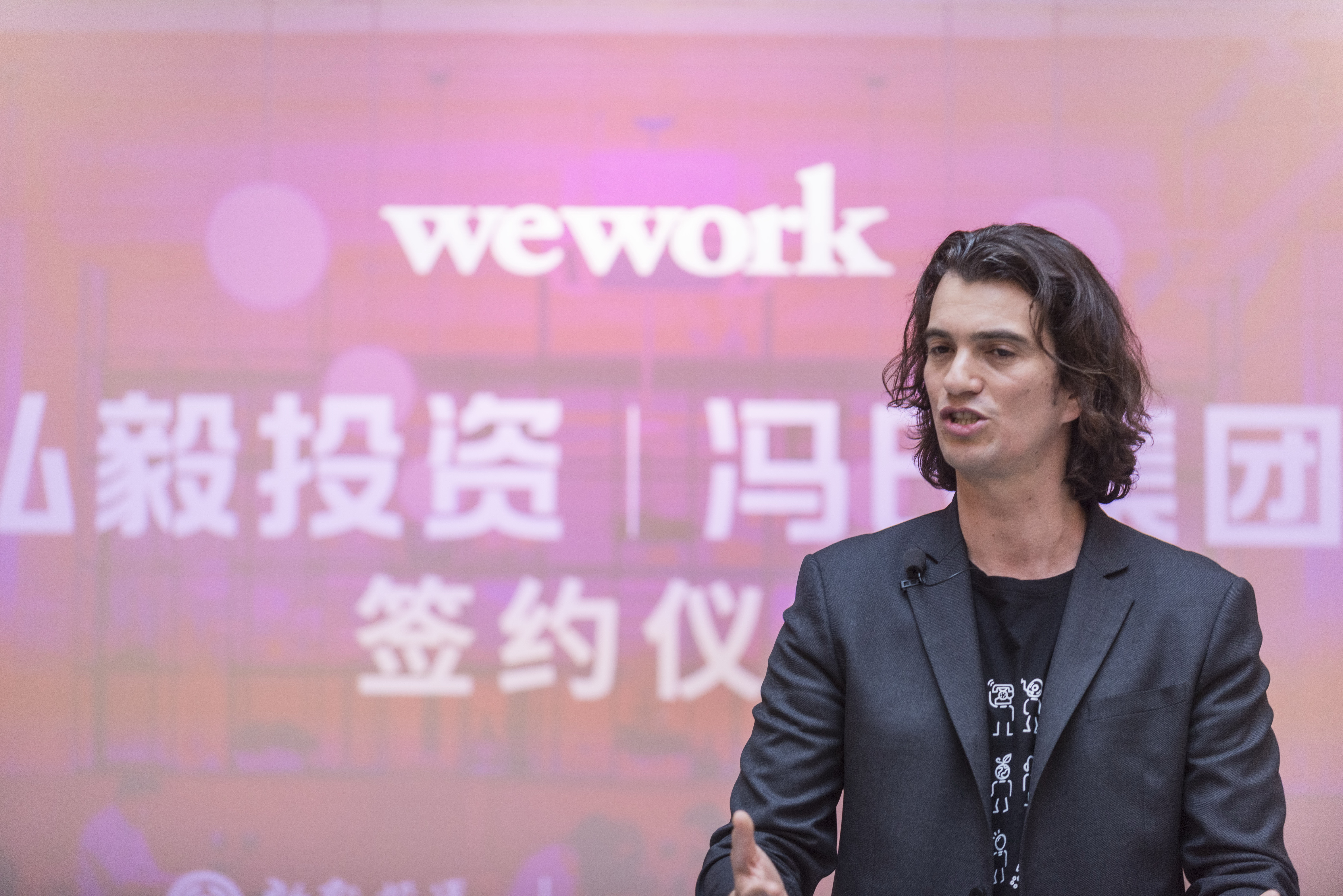 SHANGHAI, CHINA - APRIL 12:  Adam Neumann, co-founder and chief executive officer of WeWork, speaks during a signing ceremony at WeWork Weihai Road flagship on April 12, 2018 in Shanghai, China. World's leading co-working space company WeWork will acquire China-based rival naked Hub for 400 million U.S. dollars.
