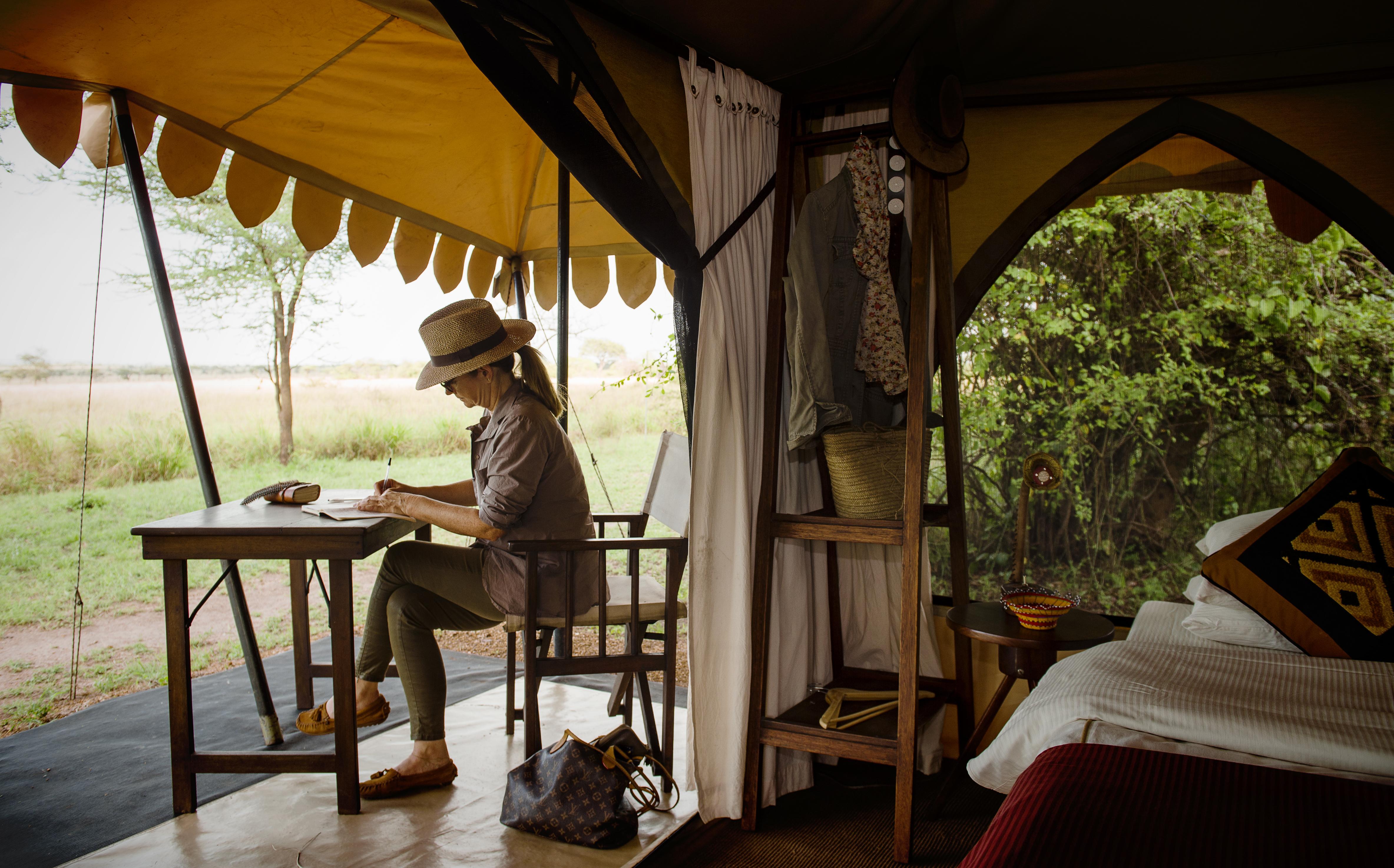 Journal writing on safari with AdventureWomen, a female-run tour company for women travelers.