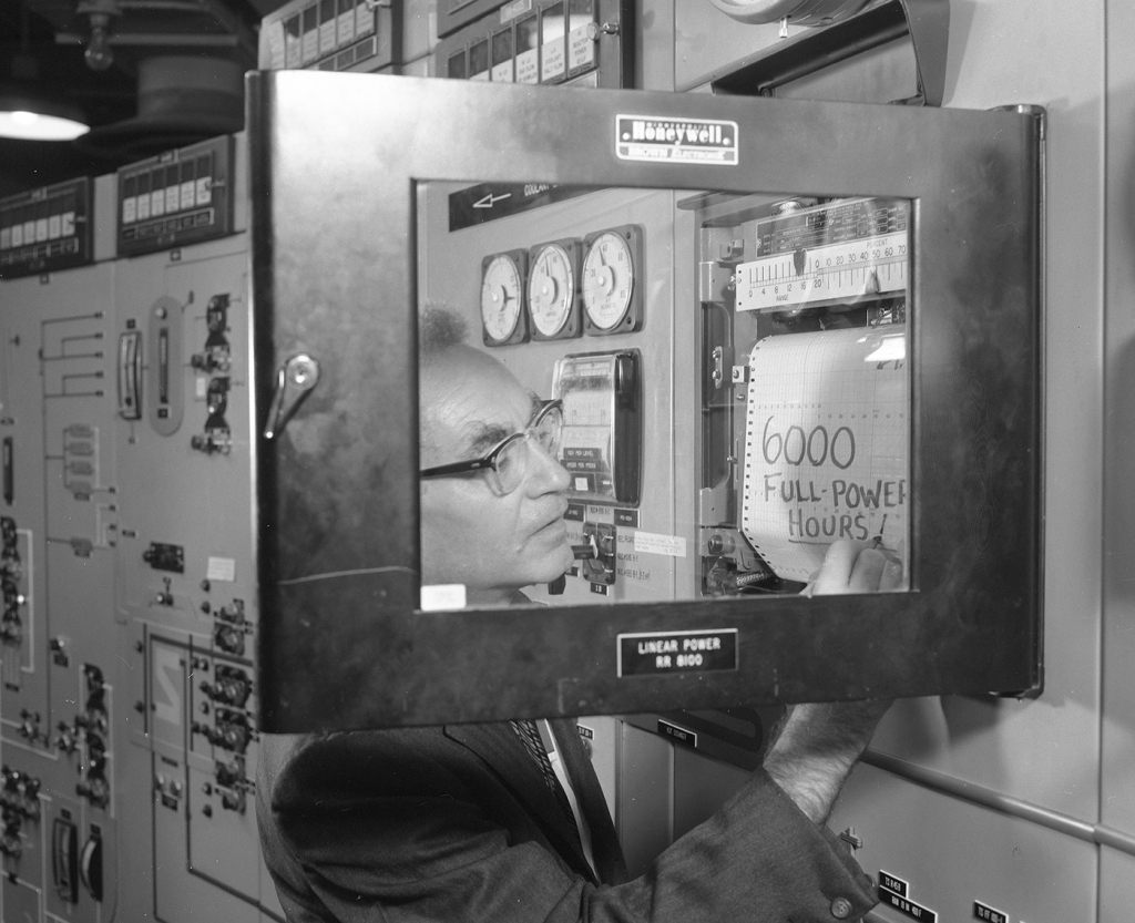 Many Gen IV designs have been around for decades. Here Alvin Weinberg, who developed an experimental molten salt reactor at the U.S'.s Oak Ridge National Laboratory in the 1960s, marks 6,000 hours of its operation in 1967. ORNL is now part of the Department of Energy. [Photo from ORNL].