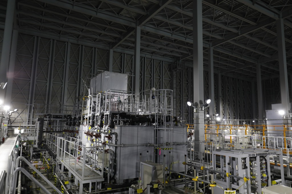 Multi-nuclide removal facility, or advanced liquid processing system (ALPS), used for treating contaminated water accumulated, is seen during a media tour of Tokyo Electric Power Co's (TEPCO) Fukushima Dai-Ichi nuclear power plant in Okuma, Fukushima, Japan, on Wednesday, Oct. 2, 2019. TEPCO is considering a plan to dump roughly 1 million cubic meters of treated radioactive water, enough to fill 400 Olympic-size swimming pools, from the wrecked Fukushima Dai-Ichi nuclear power plant into the Pacific Ocean, part of its $200 billion effort to clean up the worst atomic accident since Chernobyl. Photographer: Hitoshi Katanoda/Polaris Images/Bloomberg via Getty Images
