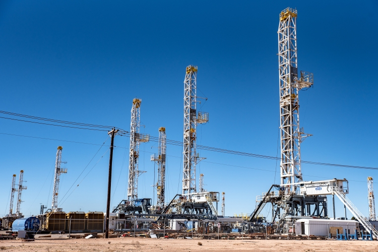 Oil rigs stand in the Permian Basin area of Odessa, Texas.