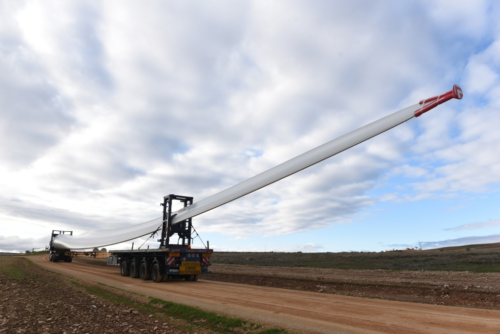 MADRID, SPAIN - 2019/12/05: Special transport truck is seen transporting the blade of a wind turbine near the small village of Beltejar. Construction work continues on a new wind farm in Beltejar, north of Spain. During COP25, the Spanish president Pedro Sanchez pledged to reduce the level of CO2 emissions by 20% in the next years. (Photo by John Milner/SOPA Images/LightRocket via Getty Images)