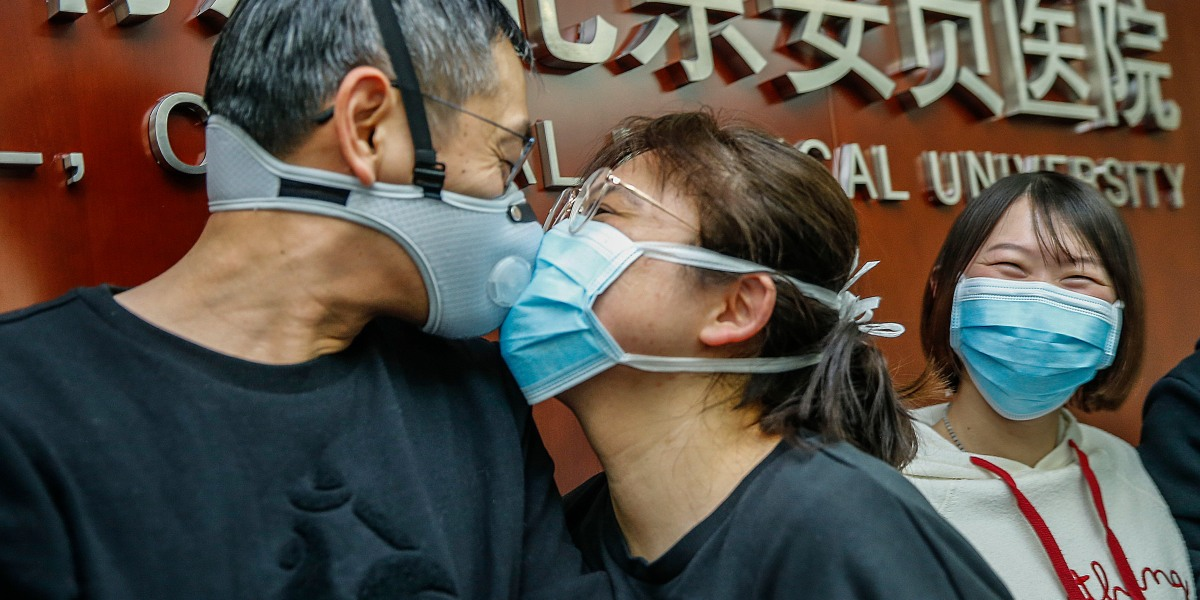 Remain 'standoffish:' virologists pan kissing and high fives as the coronavirus spreads
