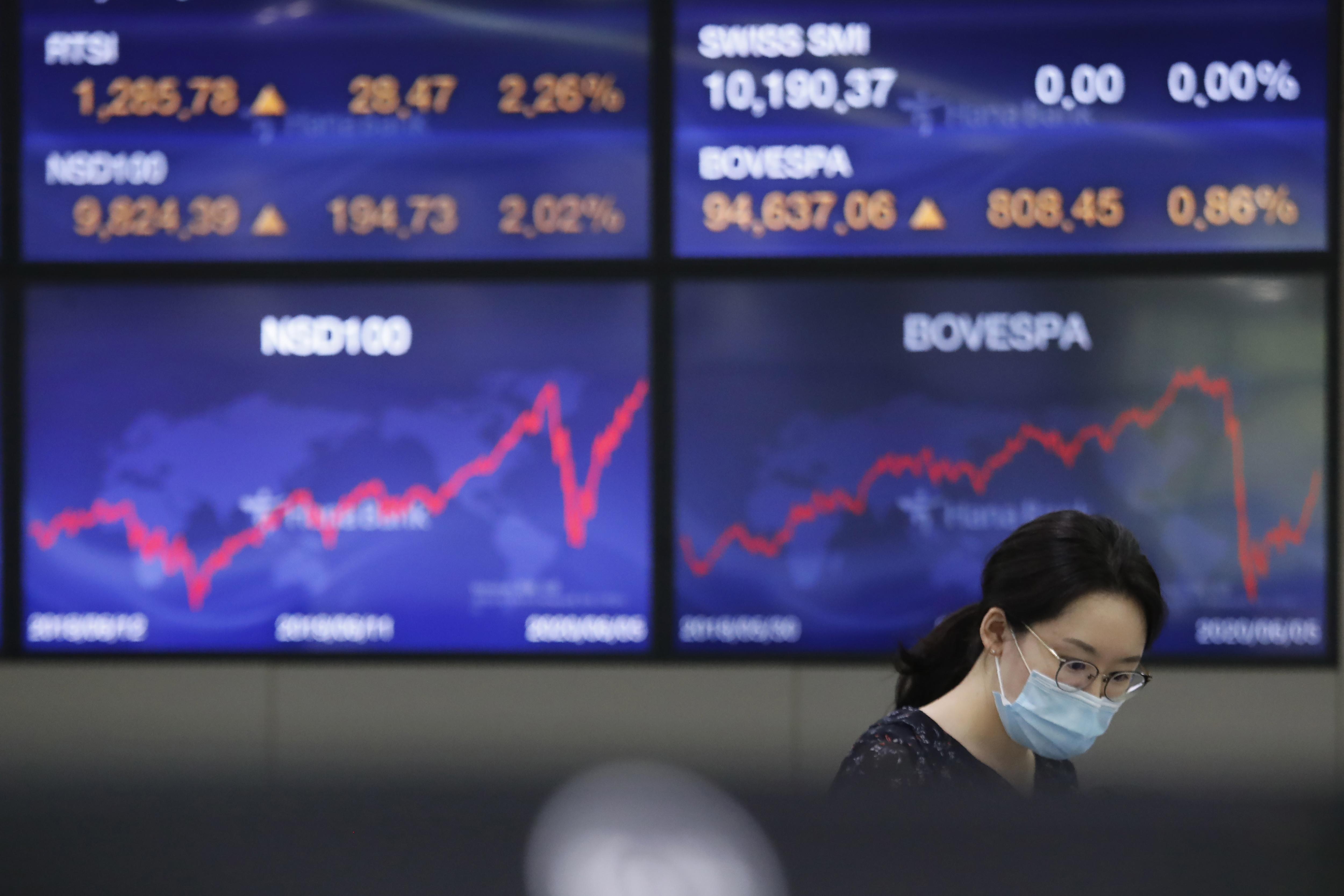 Nasdaq hits record as stocks continue to soar thumbnail