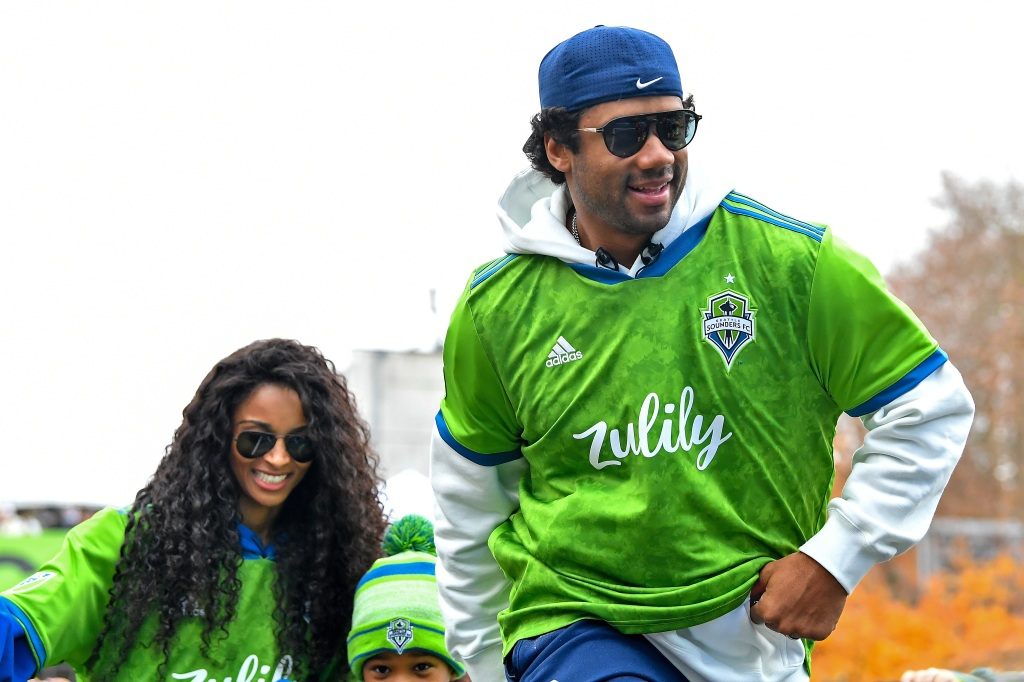Seattle Seahawks quarterback Russell Wilson, right, and recording artist Ciara during the MLS Cup Champions Parade on November 12, 2019 in Seattle.