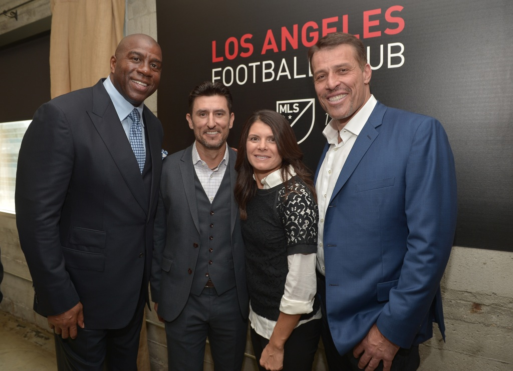"""LAFC owners Earvin """"Magic"""" Johnson, Nomar Garciaparra, and Mia Hamm with author Tony Robbins on October 30, 2014 in Hollywood, California."""
