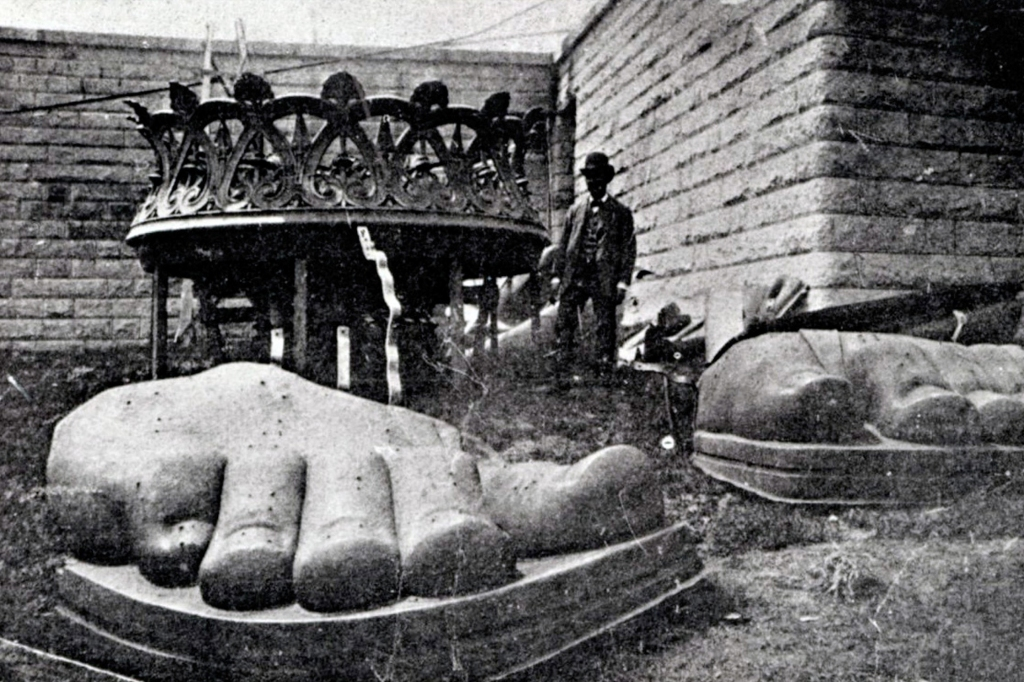 The feet of the Statue of Liberty arrive on Bedloe Island